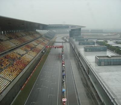 GP125 - Chine D.3: Iannone se mouille. Di Meglio second