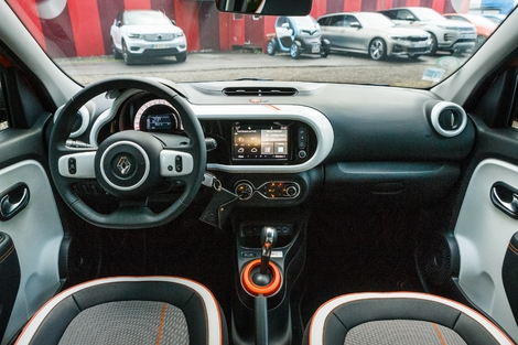 The Twingo is more modern in design, despite its older age.  And more colorful.  But plastics are all hard too.