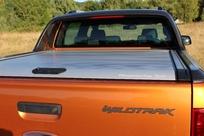 La benne peut être couverte (en option) d'un hard-top ou d'un volet.