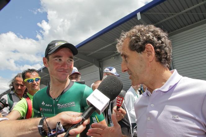 Alain Prost en Renault Fluence Z.E. sur le TdF