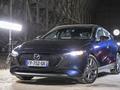 Mazda 3: différente - Salon de l'auto Caradisiac