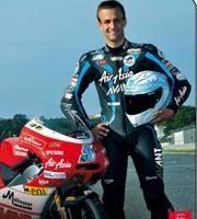 GP125 - France: Johann Zarco arrive au Mans bien habillé et bien accompagné