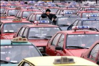 Jeux Olympiques à Pékin : les chauffeurs de taxi ne doivent pas avoir le crâne rasé et une barbe