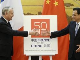 Economie: en voyage en Chine, le premier ministre cite en exemple le groupe PSA