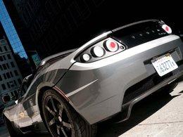 Mondial de Paris 2010 : le bilan du tour du monde en Tesla Roadster TAG Heuer électrique